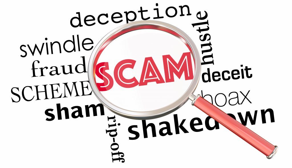 Magnify glass over words like scam and hoax, deception, fraud.